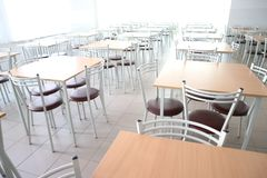 School dining room with a lot of tables and chairs Royalty Free Stock Photos