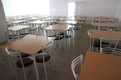School dining room with a lot of tables and chairs Stock Photos