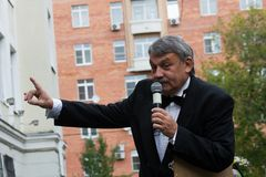 The school Director Sergei Kazarnovskii. Moscow, Russia - September 1, 2014. The school Director Sergei Kazarnovskii welcomes the beginning of the school year Royalty Free Stock Images