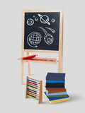 School doodles in chalkboard background. Black wall with school doodles with books and pencil royalty free illustration