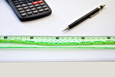 School and drawing. Calculator, pencil and ruler lying on white paper Stock Photos