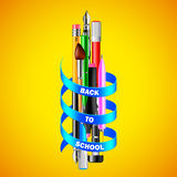 School drawing tools with blue ribbon on yellow background Royalty Free Stock Image