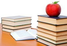Books tower with apple isolated on white. School and Education. Books tower with apple isolated on white stock photos