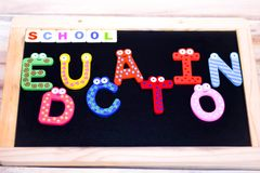 SCHOOL EDUCATION WRITTEN WITH BLOCK LETTERS ON CHALKBOARD royalty free stock images