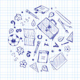 School elements on a squared paper Royalty Free Stock Photo