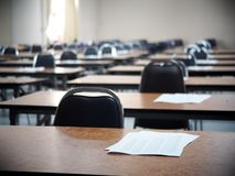 School empty cold exam class room desk and chair