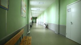 School empty corridor interior green wall to right stock footage