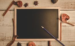 School empty wooden blackboard on wooden floor with pencil and dry leaves. Education and Nature concept. Back to school theme. Top royalty free stock images