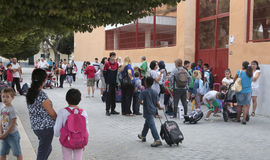 School entry time. Children and parents wait with their bags the time their school open doors in Palma de mallorca, on the Spanish balearic island of mallorca Royalty Free Stock Photography