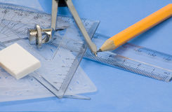 School equipment. Geometry set for school with a ruler ,compass, protractor,pencil ,pencil sharper eraser Stock Image