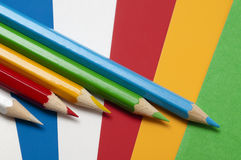 School equipment: colored pencils on colored paper Royalty Free Stock Photos