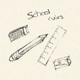 School equipment on a lined paper Royalty Free Stock Photos