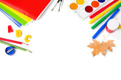 School equipment with pencils, paints , brushes and autumn leaves. Royalty Free Stock Photo
