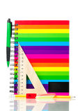 School exercise-book. With stationery on white background Royalty Free Stock Photos