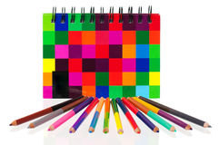 School exercise-book. With colour pencils on white background Royalty Free Stock Photo