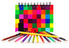 School exercise-book. With multi-colored pencils on white background Stock Image