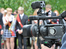 School farewell ring. Operator recording a holiday on a video camera Stock Image