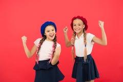 School fashion concept. Pupil smiling girls wear formal uniform and beret hats. International exchange school program. Education abroad. Apply form enter stock images
