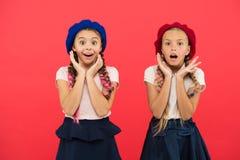 School fashion concept. Surprised girls wear formal uniform red background. International exchange school program. Education abroad. Apply form enter stock image