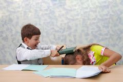 School. Fight on lesson! Royalty Free Stock Photos