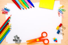 School Frame Background Copyspace. Set of crayons, scissor, colored clips, pushpins, pegs, post-its, felt-tip colored pens and other useful supplies for the