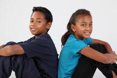 School friendship boy and girl sitting together. Friendship of young school boy, 11 sitting with school girl 10 Royalty Free Stock Photos