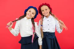 School friendship. Schoolgirls wear formal school uniform. Children beautiful girls long braided hair. Little girls with royalty free stock photography