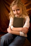School girl. Little school girl with brown book Royalty Free Stock Images