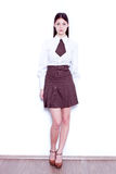 School girl. Teen school girl wearing formal clothes and standing against a white wall - isolated Royalty Free Stock Photo