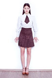 School girl. Teen school girl wearing formal clothes and standing against a white wall - isolated Royalty Free Stock Photography