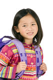 School Girl. A young asian school girl ready for school Royalty Free Stock Photos