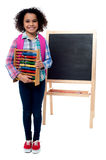 School girl with abacus and pink backpack Stock Photography