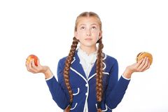 School girl with apple and hamburger Royalty Free Stock Images