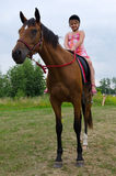 School girl on arabian horse Royalty Free Stock Images