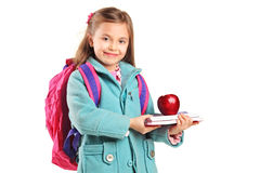 School girl with backpack holding a notebook Stock Images