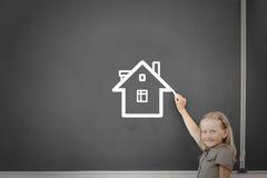 School girl at blackboard. Cute little girl drawing house on blackboard Royalty Free Stock Image