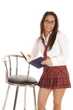 School girl book stand stool Stock Image
