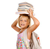 School girl with Books. Back to School concept.Happy Cute Little Girl with books over white background Royalty Free Stock Image