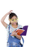 School girl with books. School girl thinking in study Royalty Free Stock Photo