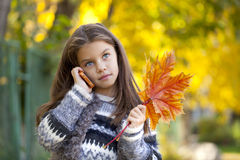 School girl calling by phone Stock Photography