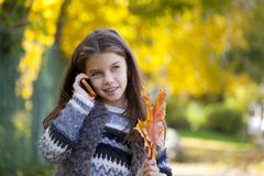 School girl calling by phone Royalty Free Stock Photos