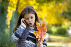 School girl calling by phone Royalty Free Stock Image