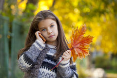School girl calling by phone Stock Image