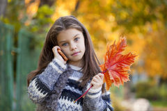 School girl calling by phone Royalty Free Stock Photo