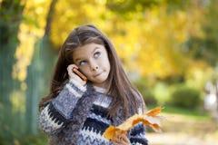School girl calling by phone Stock Image