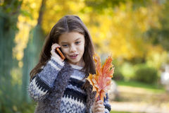 School girl calling by phone Stock Images