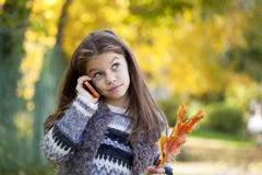 School girl calling by phone Royalty Free Stock Photography