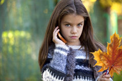School girl calling by phone Royalty Free Stock Images