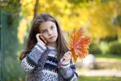 School girl calling by phone Stock Photos