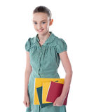 School girl carrying books in hand Royalty Free Stock Photo